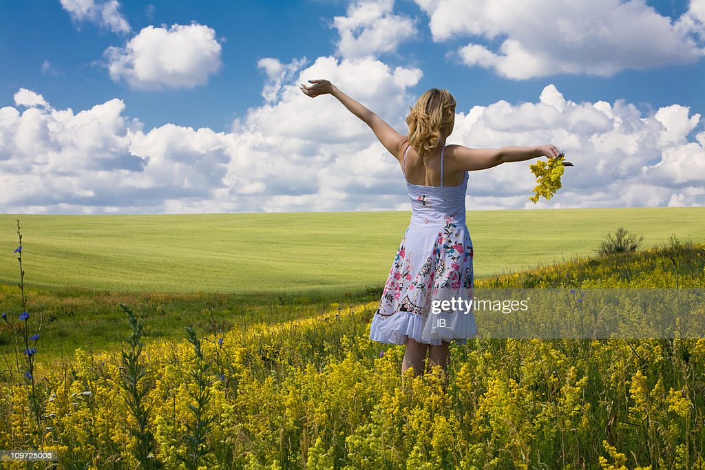 Young, Carefree Woman Wearing Dress Outside in a Meadow : Stock Photo