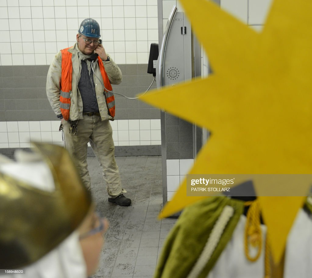A young carol singer visits the coal mine Prosper Haniel Schacht 10 on January 4, 2013 in Bottrop, western Germany. The 2013 'Three King's Action' charity focuses on the plight of children in Tanzania. AFP PHOTO / PATRIK STOLLARZ