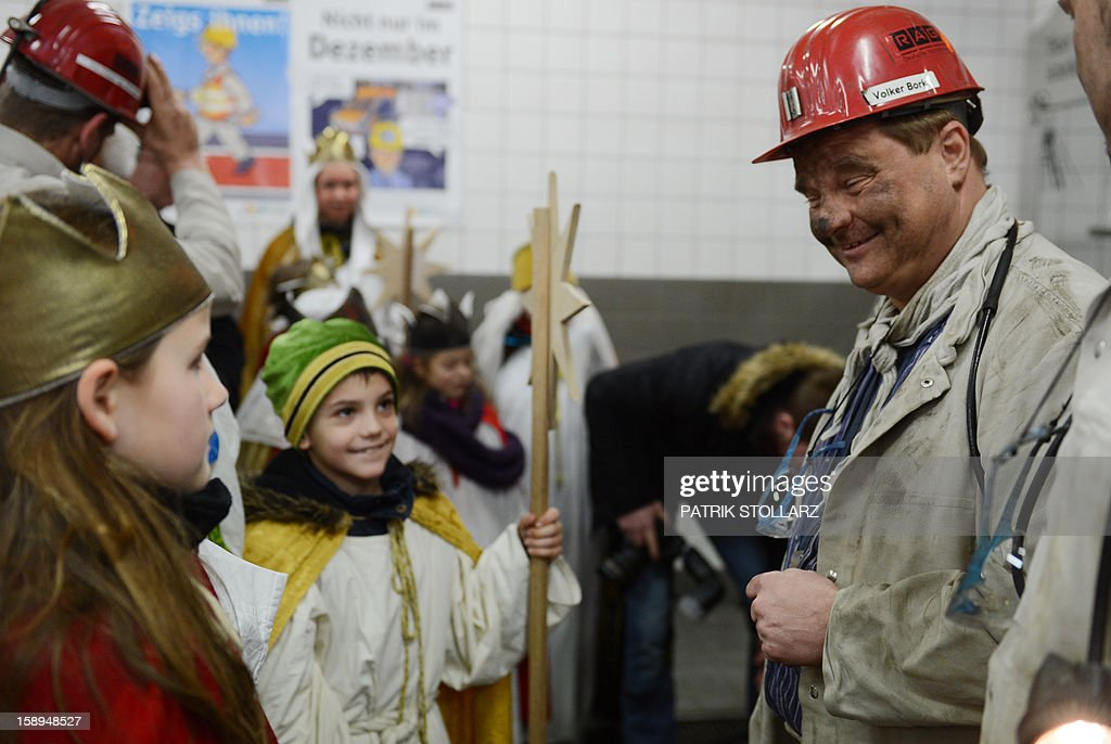 Young carol singers visit the coal mine Prosper Haniel Schacht 10 on January 4, 2013 in Bottrop, western Germany. The 2013 'Three King's Action' charity focuses on the plight of children in Tanzania.