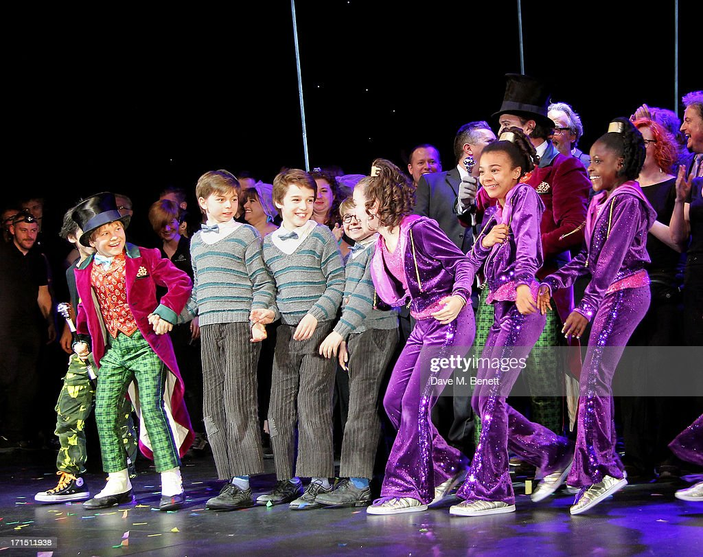 Young cast members including Jack Costello, Tom Klenerman, Isaac Rouse, Louis Suc, Adrianna Bertola, India Ria Amarteifio and Jade Johnson bow at the curtain call during the press night performance of 'Charlie And The Chocolate Factory' at the Theatre Royal Drury Lane on June 25, 2013 in London, England.