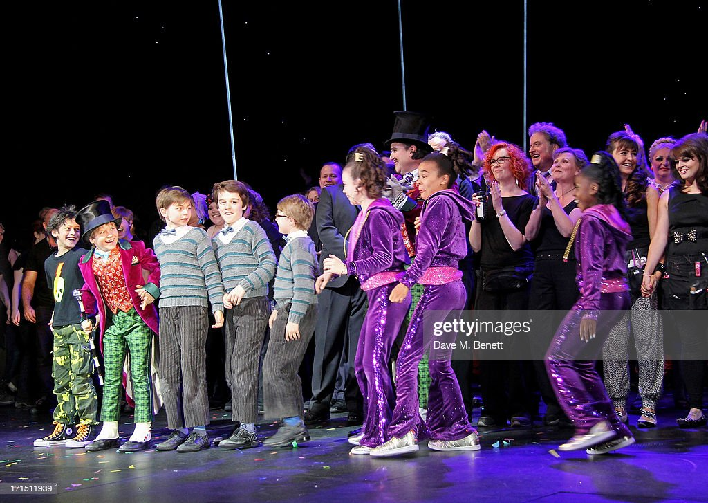 Young cast members Jay Heyman, Jack Costello, Tom Klenerman, Isaac Rouse, Louis Suc, Adrianna Bertola, India Ria Amarteifio and Jade Johnson bow at the curtain call during the press night performance of 'Charlie And The Chocolate Factory' at the Theatre Royal Drury Lane on June 25, 2013 in London, England.