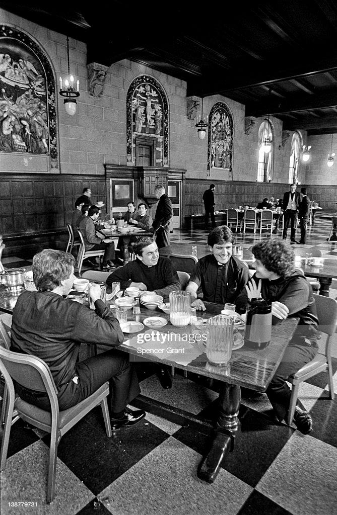 Young Catholic seminarians have lunch in the refectory of Saint John's Seminary Brighton Massachusetts 1975