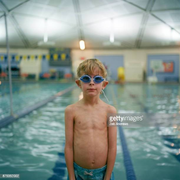 Young caucasian boy at the swimming pool