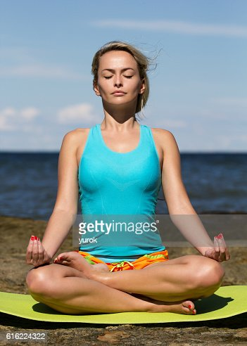 young caucasian fitness woman practicing yoga : Photo