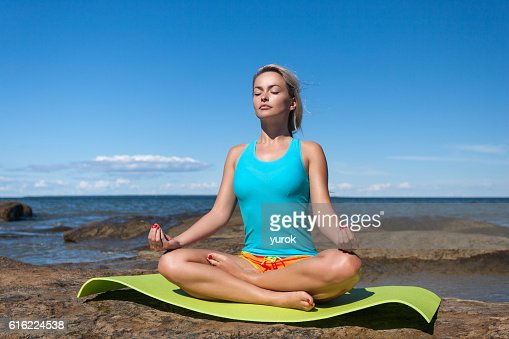 young caucasian fitness woman practicing yoga : ストックフォト