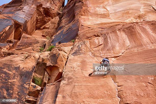 Young Caucasian Man Climbing a Rock Wall Near Moab