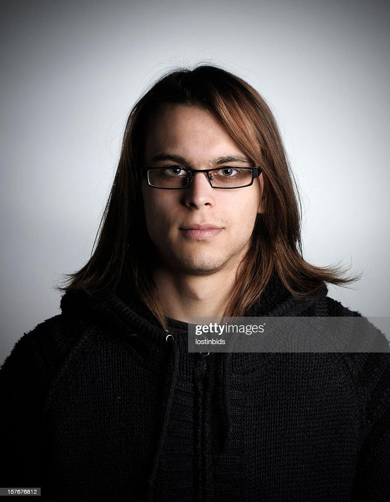 Young Caucasian Man Sporting A Rock Star Look : Stock Photo