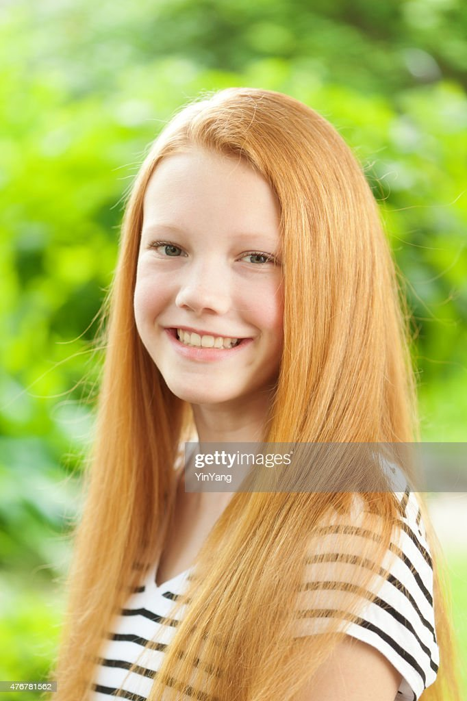 Teenage Caucasian Girl15 Years Old Sitting Outdoors: Young Caucasian Teen Girl With Reddish Blond Hair Portrait
