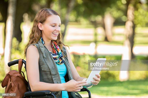 Young Caucasian woman in wheelchair on college campus