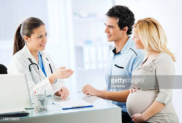 Young cheerful couple visiting a doctor