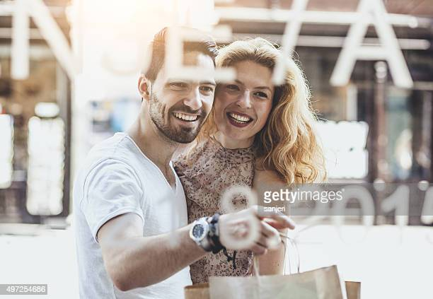 Young cheerful couple walking by the street