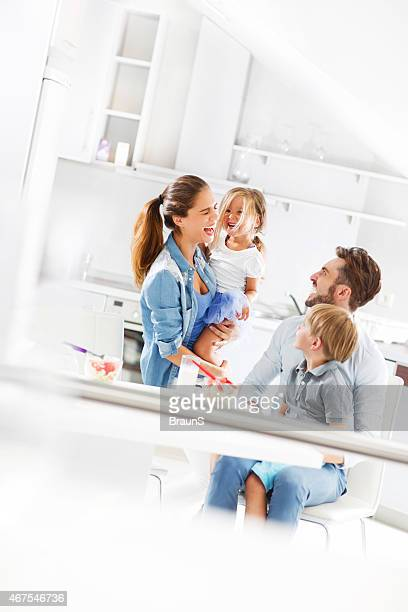 Young cheerful family having fun in the kitchen.
