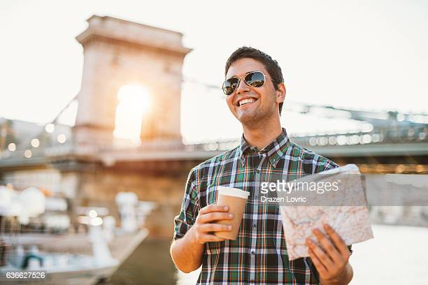 Young cheerful tourist discovering Europe