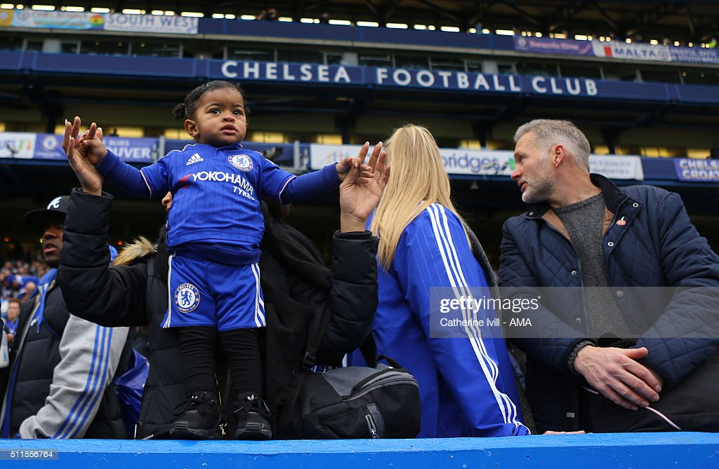 A young Chelsea fan wearing a kit stands on the wall before the Emirates FA Cup match between Chelsea and Manchester City at Stamford Bridge on February 21, 2016 in London, England.