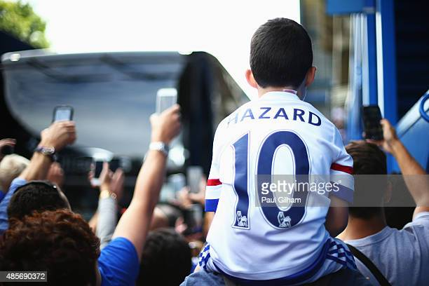 A young chelsea fan wearing an Eden Hazard of Chelsea shirt as the team bus arrives ahead of the Barclays Premier League match between Chelsea and...