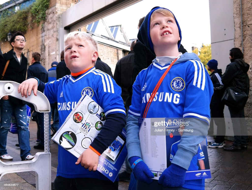 Young Chelsea fans ahead of the Barclays Premier League match between Chelsea and West Bromwich Albion at Stamford Bridge on November 9, 2013 in London, England.