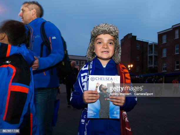 A young Chelsea supporter arrives for the UEFA Champions League group C match between Chelsea FC and AS Roma at Stamford Bridge on October 18 2017 in...