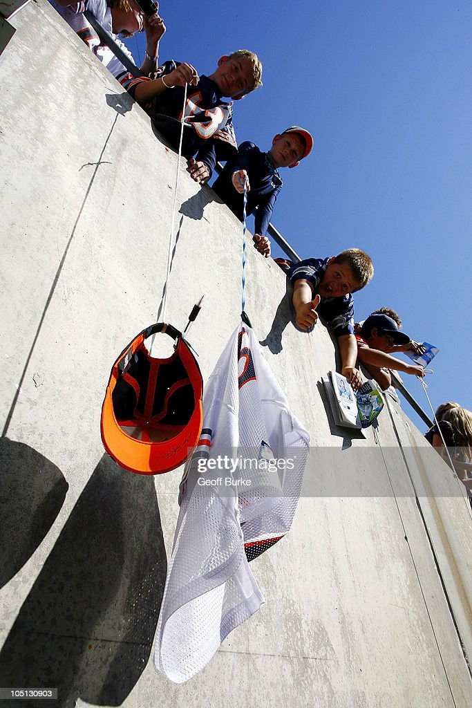 Young Chicago Bears fans wait for autographs from Bears' players during warm ups prior to the Bears game against the Carolina Panthers at Bank of America Stadium on October 10, 2010 in Charlotte, North Carolina.