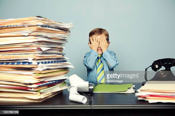 Young Child Accountant with Lots of Work at Office