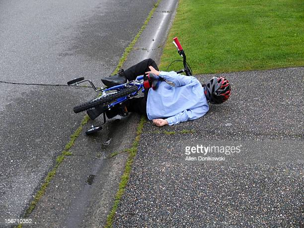 Young child crashes his bicycle and lays on ground