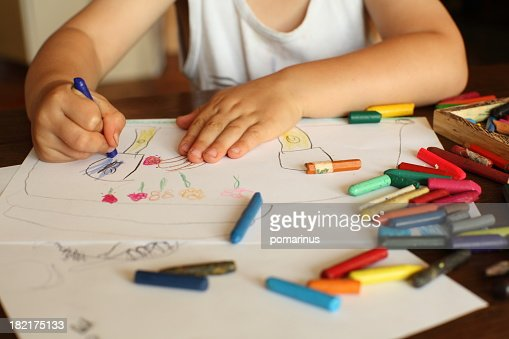 Young child drawing and coloring