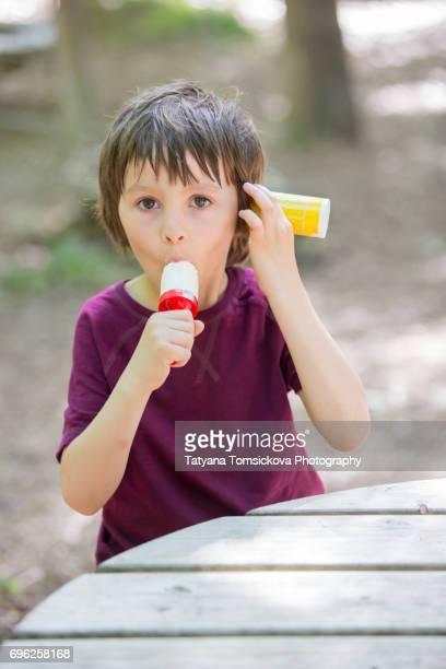 Young child, eating ice cream in a park, springtime