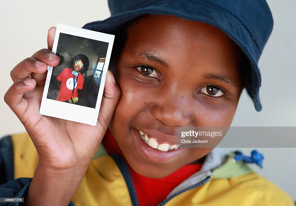 A young child holds up an instant photograph they took during a photography session at the Sentebale Mamohato Children's Camp on October 17, 2015 in Maseru, Lesotho. Getty Images have partnered with Prince Harry's Charity Sentebale to help bring photography to some of the vulnerable children of Lesotho. In an ongoing project and with the Support of Fujifilm Getty Images has helped develop and run lessons with children at the new Sentebale Mamohato Children's Centre as a way of helping develop interpersonal, creative and communication skills amongst some of the most disadvantaged children in the world. Sentebale was founded by Prince Harry and Prince Seeiso of Lesotho ten years ago.