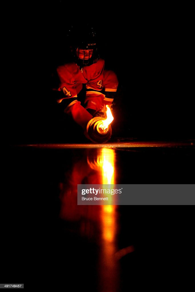 A young child in a Montreal Canadiens uniform carries a torch before the Canadiens take on the New York Rangers in Game One of the Eastern Conference Finals of the 2014 NHL Stanley Cup Playoffs at the Bell Centre on May 17, 2014 in Montreal, Canada.