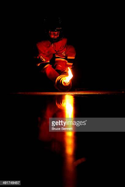 A young child in a Montreal Canadiens uniform carries a torch before the Canadiens take on the New York Rangers in Game One of the Eastern Conference...