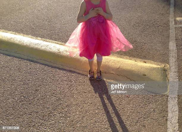 Young child in pink dress with sunlight