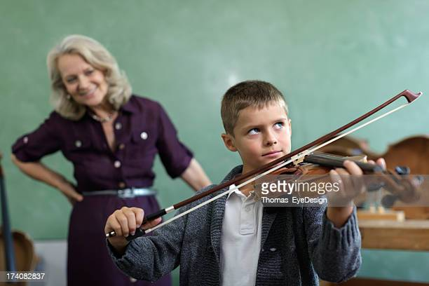 Young Child Learning to Play Violin