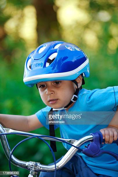 Young child learning to ride a bike