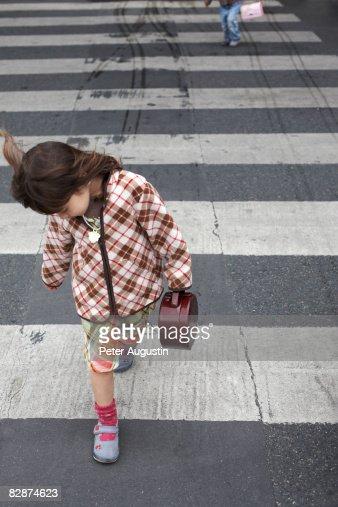 young child on crosswalk : Stock Photo