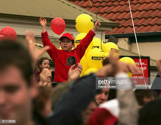 Young child on the shoulders of his father among the large crowd at the auction of the two last units of the second series of the reality tv show...