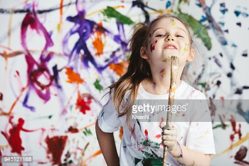 Young child painter standing with a brush : Stock Photo