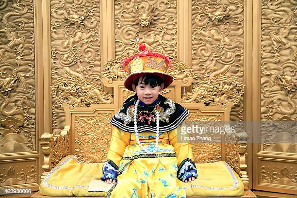 A young child pose for photos dressed as a Qing Dynasty clothing at Jingshan Park falls on February 20 2015 in Beijing China China celebrated its new...