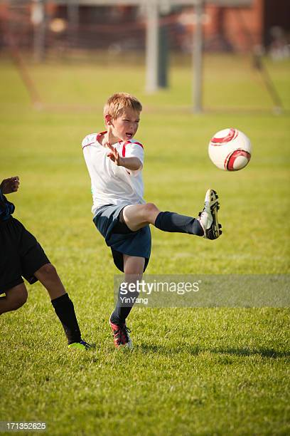 Young Child Soccer Player in Game Action