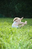 Young child toppling over on grass