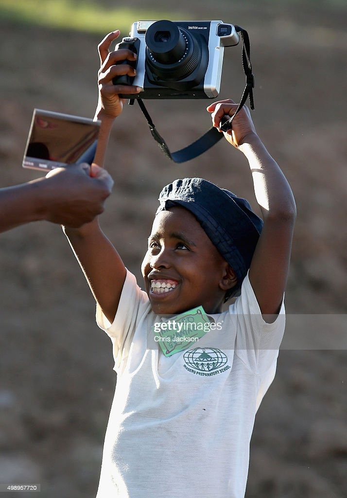 A young child uses a Fuji Instant Camera during a community camp at the Sentebale Mamohato Children's Centre on October 17, 2015 in Maseru, Lesotho. Getty Images have partnered with Prince Harry's Charity Sentebale to help bring photography to some of the vulnerable children of Lesotho. In an ongoing project and with the Support of Fujifilm Getty Images has helped develop and run lessons with children at the new Sentebale Mamohato Children's Centre as a way of helping develop interpersonal, creative and communication skills amongst some of the most disadvantaged children in the world. Sentebale was founded by Prince Harry and Prince Seeiso of Lesotho ten years ago.