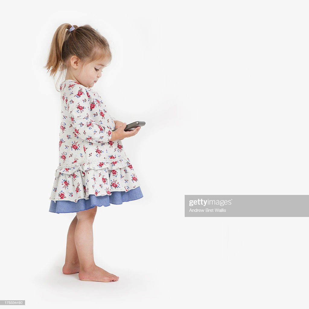 young child using a mobile communication device : Stock Photo