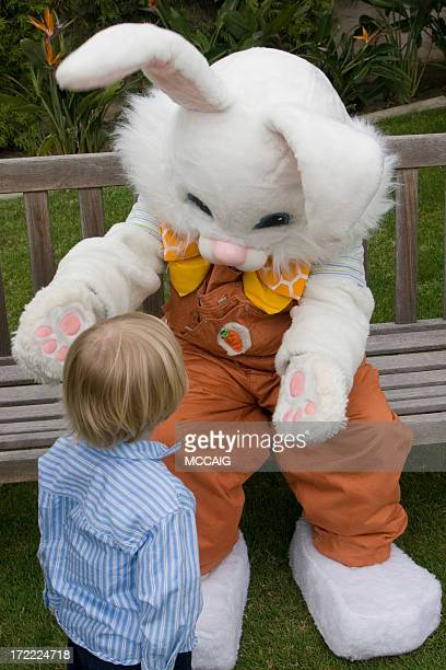 Young child walking up to Easter bunny
