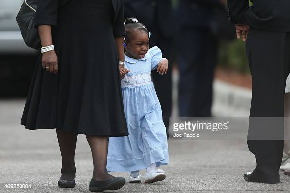A young child walks among mourners as they attend the funeral service for Walter Scott at the WORD Ministries Christian Center after he was fatally...