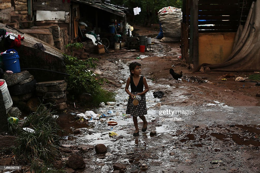 A young child walks home in an area known for heavy drug dealing on July 18 2012 in Tegucigalpa Honduras Honduras now has the highest per capita...