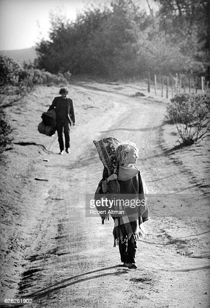 A young child walks on Coleman Valley Road heading towards Wheelers Ranch on March 25 1970 in Occidental California