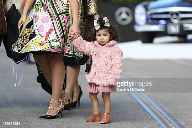 A young child wearing a chanel brooch and a Louis Vuitton bag at MercedesBenz Fashion Week Australia 2015 at Carriageworks on April 14 2015 in Sydney...