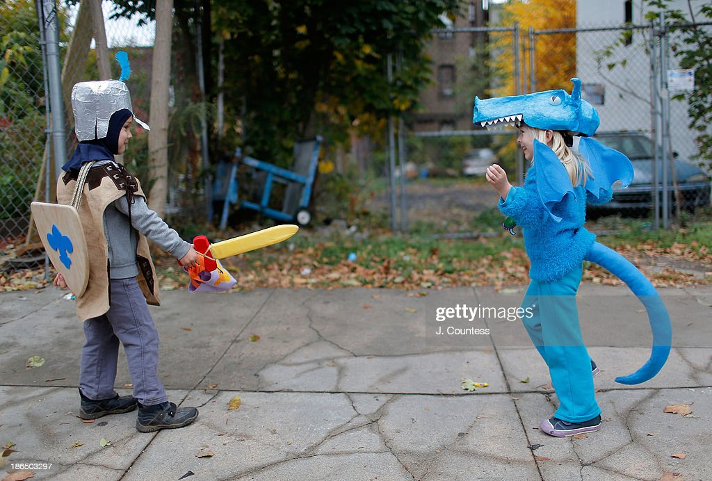 Young childen of Bedford-Stuyvesant role-play as they 'Trick or Treat' in BedfordÐStuyvesant, Brooklyn on October 31, 2013 in New York City.