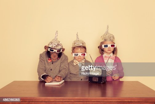 Young Children and Chimpanzee Wear Tinfoil Hats