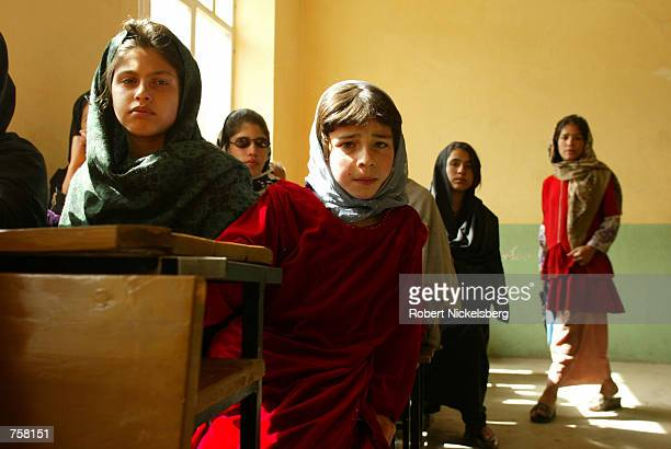 Young children at the Ariana High School run into their classrooms on the first day of school March 23 2002 in Kabul Afghanistan Kabul and other...