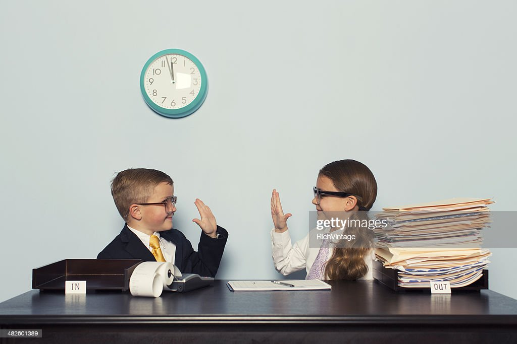 Young Children Business Team Give High Five : Stock Photo