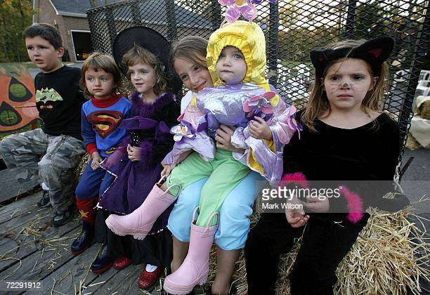 Young children dressed in various costumes get ready for a hay ride during a Halloween party October 28 2006 in Huntingtown Maryland Halloween is on...
